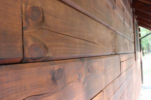 log cabin stain highlights wood