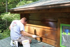 hand applied staining for log cabin