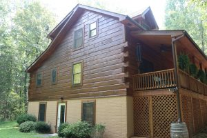 log home with new stain