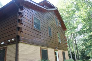 brand new stain job on log home